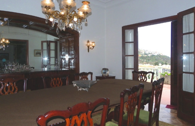 Exquisite dining room with large table and bar