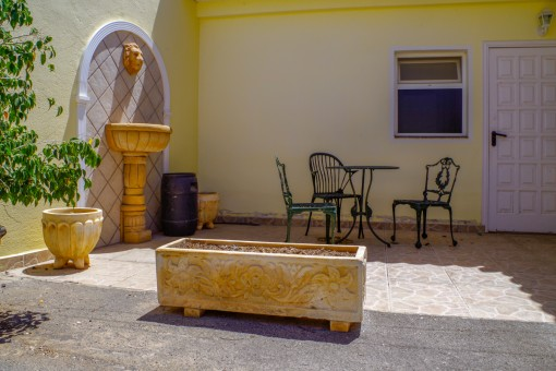 Wonderful patio with lounge area  of the guesthouse