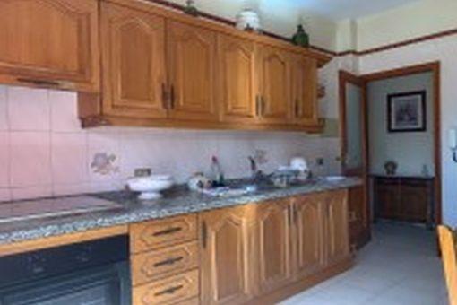 Large, wooden kitchen