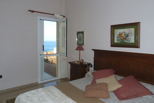 Spacious bedroom with sea view