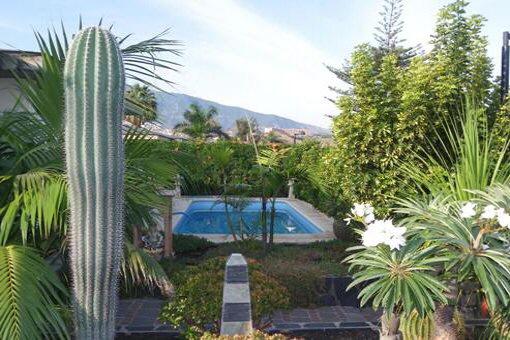 The swimming pool, set in beautiful surroundings