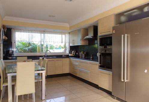 Large kitchen with ceramic hob and extractor hood