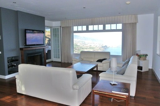 The bright modern living room with terrace and panoramic sea views