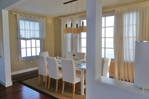 Elegant dining area with large windows