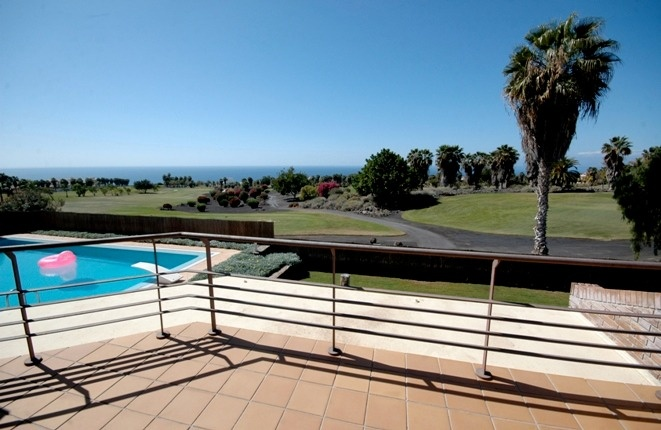 Perfectly: terrace, pool with springboard, and the green of the golf course with the  Atlantic Ocean on background