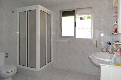 Bathroom with shower cubicle and window
