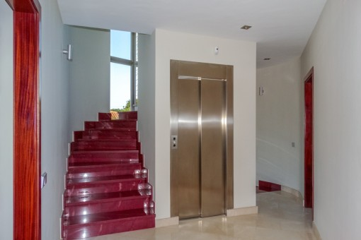 Elevator next to the staircase