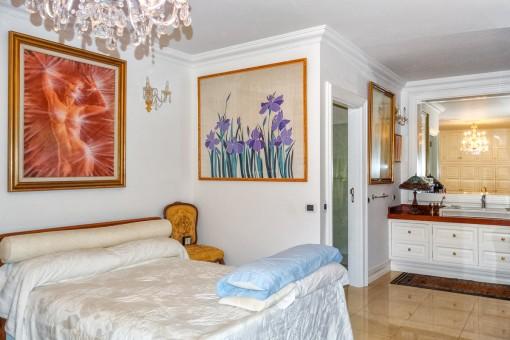 Spacious double bedroom with built-in wardrobe and bathroom en suite