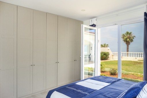 Bright master bedroom with built-in wardrobe