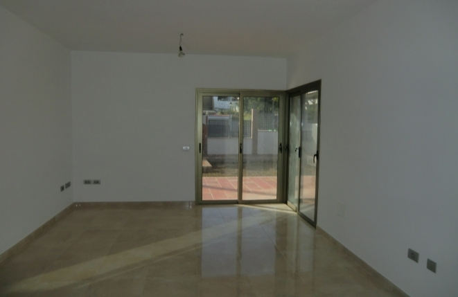 Living room with access to the terrace and garden