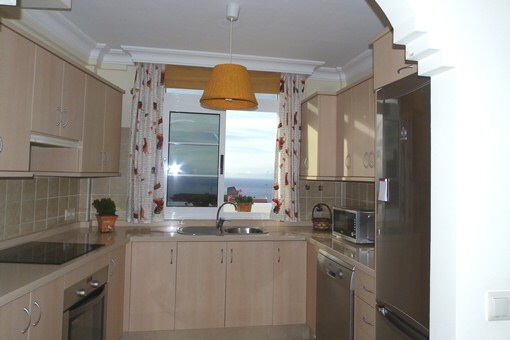 The fully equipped kitchen with views of the sea