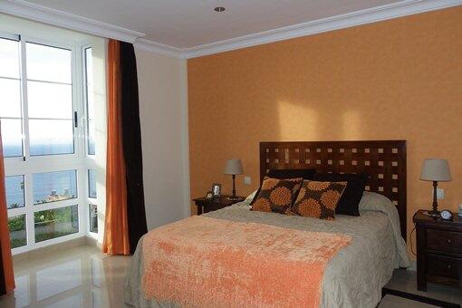 Stylish bedroom with wonderful sea view