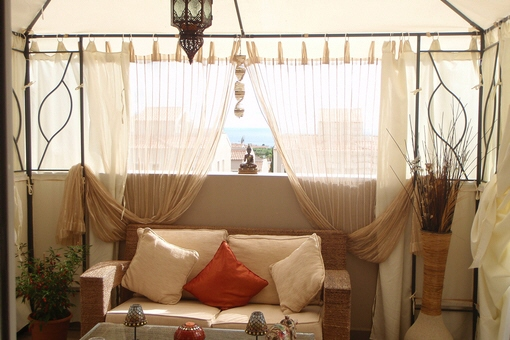 The cozy gazebo on the terrace with spectacular sea views