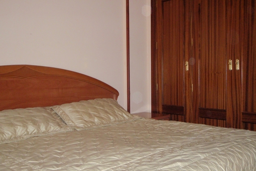 Master bedroom with double bed and large wardrobe