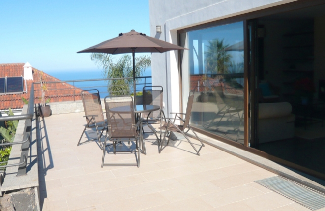 Terrace next to the living room with sea view