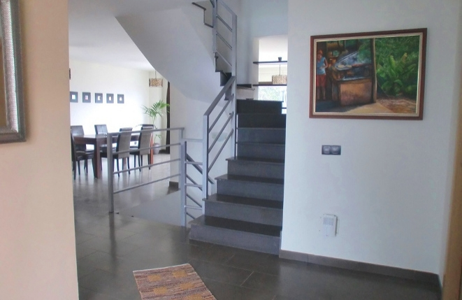 View of the staircase and the dining room