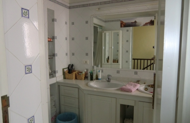 Shared bathroom with large mirror