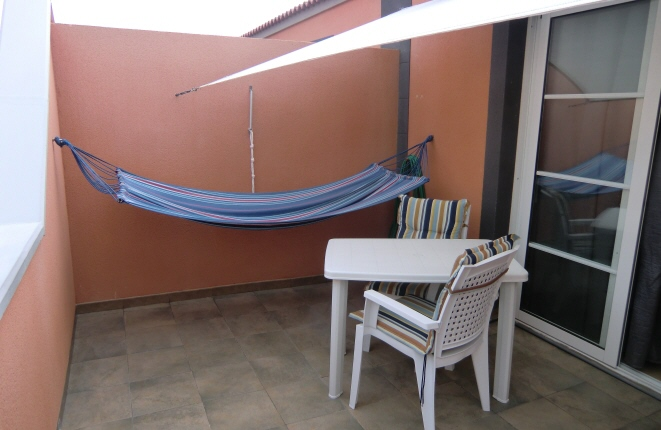 Upstairs terrace invites you to relax