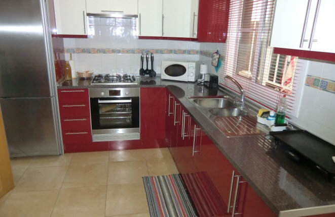 As new and fully equipped kitchen