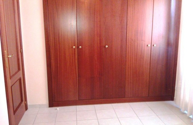 Large fitted wardrobes in the bedroom