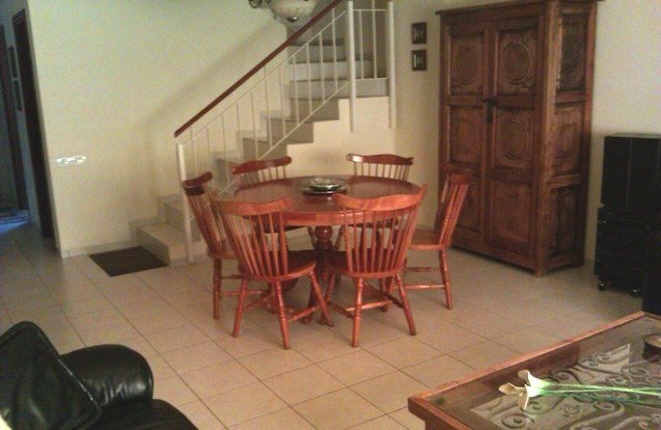 Living room with dining table and staircase