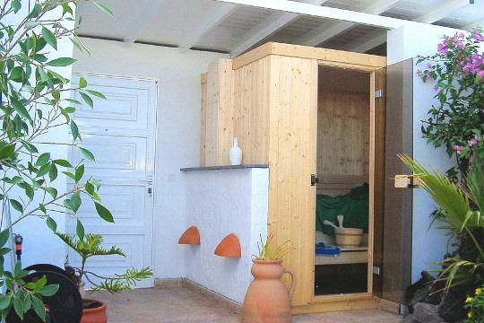 Outdoor sauna with shower