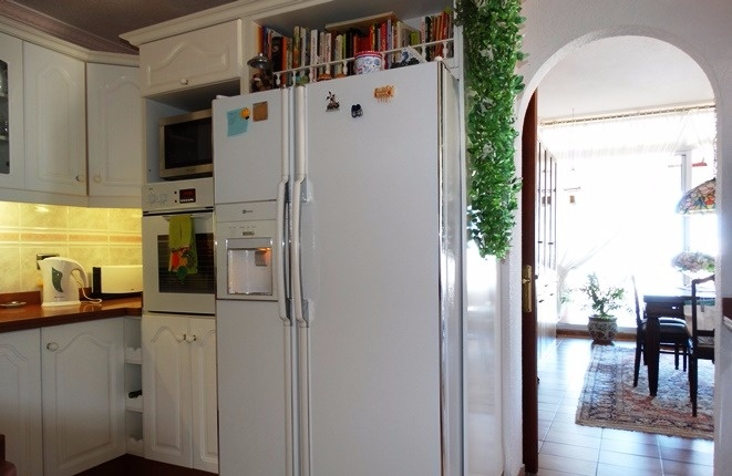 Arched passage to the salon, beside the refrigerator with icemaker