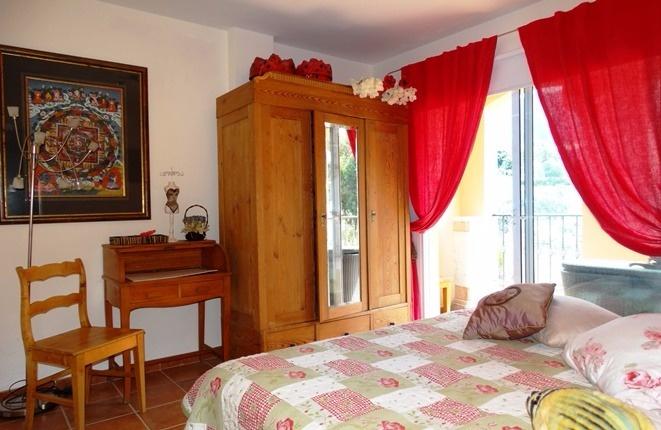 Comfortable bedroom with balcony