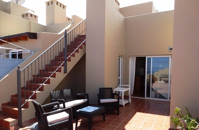 Terrace lounge and stairway to the roof terrace