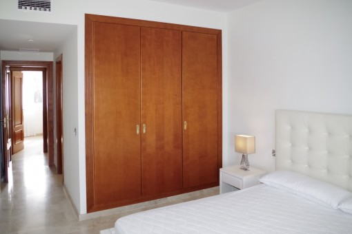 Large master bedroom with built-in wardrobe