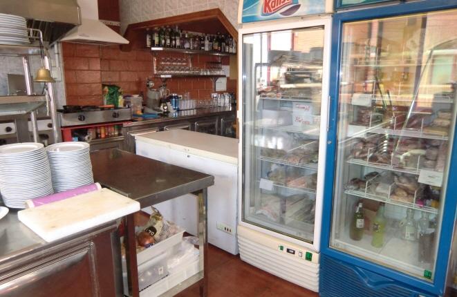 Kitchen with fridge and freezer